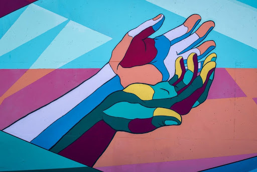 A geometric picture of two cupped hands gesturing up
